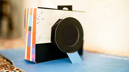 A popup book that forms a working camera