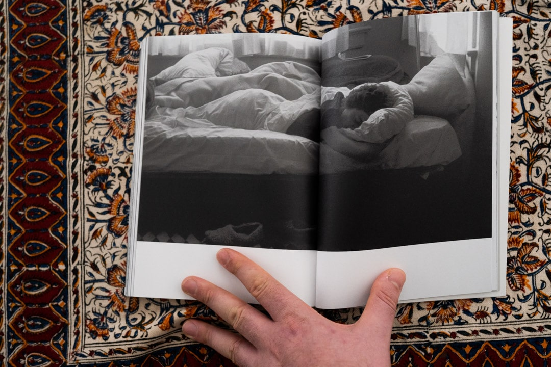 A Day Sleeper photographed and published in the book Day Sleeper, by Dorothea Lange and Sam Contis