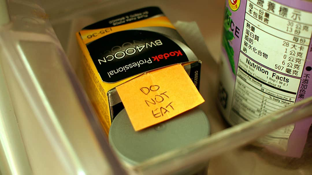 A roll of B&W super 8 film in the fridge with a cheeky note.
